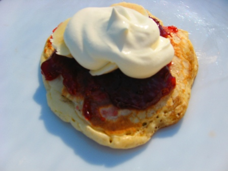 Topped_with_strawberry_jam_Sliced_banana_Whipped_cream.jpg
